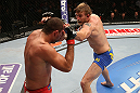 SEATTLE, WA - DECEMBER 08:  (R-L) Alexander Gustafsson punches Mauricio Rua during their light heavyweight bout at the UFC on FOX event on December 8, 2012  at Key Arena in Seattle, Washington.  (Photo by Ezra Shaw/Zuffa LLC/Zuffa LLC via Getty Images) *** Local Caption *** Mauricio Rua; Alexander Gustafsson