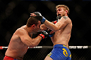 SEATTLE, WA - DECEMBER 08:  Mauricio Rua (left) punches Alexander Gustafsson (right) during their light heavyweight bout at the UFC on FOX event on December 8, 2012  at Key Arena in Seattle, Washington.  (Photo by Josh Hedges/Zuffa LLC/Zuffa LLC via Getty Images) *** Local Caption *** Mauricio Rua; Alexander Gustafsson