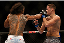 SEATTLE, WA - DECEMBER 08:  Benson Henderson (L) punches Nate Diaz (R) during their lightweight championship bout at the UFC on FOX event on December 8, 2012  at Key Arena in Seattle, Washington.  (Photo by Josh Hedges/Zuffa LLC/Zuffa LLC via Getty Images) *** Local Caption *** Benson Henderson; Nate Diaz