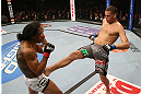 SEATTLE, WA - DECEMBER 08:  (R-L) Nate Diaz kicks Benson Henderson during their lightweight championship bout at the UFC on FOX event on December 8, 2012  at Key Arena in Seattle, Washington.  (Photo by Ezra Shaw/Zuffa LLC/Zuffa LLC via Getty Images) *** Local Caption *** Benson Henderson; Nate Diaz