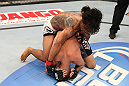 SEATTLE, WA - DECEMBER 08:  Benson Henderson (top) punches Nate Diaz during their lightweight championship bout at the UFC on FOX event on December 8, 2012  at Key Arena in Seattle, Washington.  (Photo by Ezra Shaw/Zuffa LLC/Zuffa LLC via Getty Images) *** Local Caption *** Benson Henderson; Nate Diaz