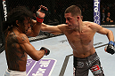 SEATTLE, WA - DECEMBER 08:  (R-L) Nate Diaz punches Benson Henderson during their lightweight championship bout at the UFC on FOX event on December 8, 2012  at Key Arena in Seattle, Washington.  (Photo by Ezra Shaw/Zuffa LLC/Zuffa LLC via Getty Images) *** Local Caption *** Benson Henderson; Nate Diaz