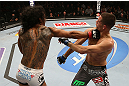 SEATTLE, WA - DECEMBER 08:  (L-R) Benson Henderson punches Nate Diaz during their lightweight championship bout at the UFC on FOX event on December 8, 2012  at Key Arena in Seattle, Washington.  (Photo by Ezra Shaw/Zuffa LLC/Zuffa LLC via Getty Images) *** Local Caption *** Benson Henderson; Nate Diaz