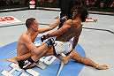 SEATTLE, WA - DECEMBER 08:  Nate Diaz (left) punches Benson Henderson (right) during their lightweight championship bout at the UFC on FOX event on December 8, 2012  at Key Arena in Seattle, Washington.  (Photo by Ezra Shaw/Zuffa LLC/Zuffa LLC via Getty Images) *** Local Caption *** Benson Henderson; Nate Diaz