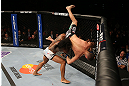 SEATTLE, WA - DECEMBER 08:  Benson Henderson (left) slams Nate Diaz (right) during their lightweight championship bout at the UFC on FOX event on December 8, 2012  at Key Arena in Seattle, Washington.  (Photo by Ezra Shaw/Zuffa LLC/Zuffa LLC via Getty Images) *** Local Caption *** Benson Henderson; Nate Diaz