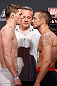 GOLD COAST, AUSTRALIA - DECEMBER 14:  (L-R) Opponents Brendan Loughnane and Mike Wilkinson face off during the UFC on FX weigh in on December 14, 2012 at Gold Coast Convention and Exhibition Centre in Gold Coast, Queensland, Australia.  (Photo by Josh Hedges/Zuffa LLC/Zuffa LLC via Getty Images)
