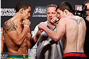 GOLD COAST, AUSTRALIA - DECEMBER 14:  (L-R) Opponents Robert Whittaker and Bradley Scott face off during the UFC on FX weigh in on December 14, 2012 at Gold Coast Convention and Exhibition Centre in Gold Coast, Queensland, Australia.  (Photo by Josh Hedges/Zuffa LLC/Zuffa LLC via Getty Images)