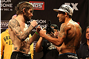 LAS VEGAS, NV - DECEMBER 14:  (L-R) Johnny Bedford and Marcos Vinicius face off during TUF 16 Finale weigh in on December 14, 2012  at the Joint at the Hard Rock in Las Vegas, Nevada.  (Photo by Jim Kemper/Zuffa LLC/Zuffa LLC via Getty Images)