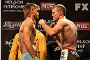 LAS VEGAS, NV - DECEMBER 14:  (L-R) Mike Pyle and James Head face off during TUF 16 Finale weigh in on December 14, 2012  at the Joint at the Hard Rock in Las Vegas, Nevada.  (Photo by Jim Kemper/Zuffa LLC/Zuffa LLC via Getty Images)