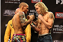 LAS VEGAS, NV - DECEMBER 14:  (L-R) Dustin Poirier and Jonathan Brookins face off during TUF 16 Finale weigh in on December 14, 2012  at the Joint at the Hard Rock in Las Vegas, Nevada.  (Photo by Jim Kemper/Zuffa LLC/Zuffa LLC via Getty Images)