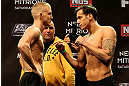 LAS VEGAS, NV - DECEMBER 14:  (L-R) Colton Smith and Mike Ricci face off during TUF 16 Finale weigh in on December 14, 2012  at the Joint at the Hard Rock in Las Vegas, Nevada.  (Photo by Jim Kemper/Zuffa LLC/Zuffa LLC via Getty Images)