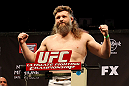 LAS VEGAS, NV - DECEMBER 14:  Roy Nelson stands on the scale during TUF 16 Finale weigh in on December 14, 2012  at the Joint at the Hard Rock in Las Vegas, Nevada.  (Photo by Jim Kemper/Zuffa LLC/Zuffa LLC via Getty Images)