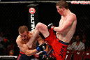 GOLD COAST, AUSTRALIA - DECEMBER 15:  (R-L) Brendan Loughnane delivers a flying knee against Mike Wilkinson during their lightweight fight at the UFC on FX event on December 15, 2012  at Gold Coast Convention and Exhibition Centre in Gold Coast, Australia.  (Photo by Josh Hedges/Zuffa LLC/Zuffa LLC via Getty Images)