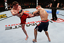 GOLD COAST, AUSTRALIA - DECEMBER 15:  (L-R) Brendan Loughnane kicks Mike Wilkinson during their lightweight fight at the UFC on FX event on December 15, 2012  at Gold Coast Convention and Exhibition Centre in Gold Coast, Australia.  (Photo by Josh Hedges/Zuffa LLC/Zuffa LLC via Getty Images)