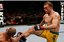 GOLD COAST, AUSTRALIA - DECEMBER 15:  (R-L) Benny Alloway kicks Manuel Rodriguez during their welterweight fight at the UFC on FX event on December 15, 2012  at Gold Coast Convention and Exhibition Centre in Gold Coast, Australia.  (Photo by Josh Hedges/Zuffa LLC/Zuffa LLC via Getty Images)