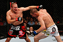 GOLD COAST, AUSTRALIA - DECEMBER 15:  (L-R) Mike Pierce punches Seth Baczynski during their welterweight fight at the UFC on FX event on December 15, 2012  at Gold Coast Convention and Exhibition Centre in Gold Coast, Australia.  (Photo by Josh Hedges/Zuffa LLC/Zuffa LLC via Getty Images)