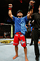 GOLD COAST, AUSTRALIA - DECEMBER 15:  Chad Mendes reacts after knocking out Yaotzin Meza during their featherweight fight at the UFC on FX event on December 15, 2012  at Gold Coast Convention and Exhibition Centre in Gold Coast, Australia.  (Photo by Josh Hedges/Zuffa LLC/Zuffa LLC via Getty Images)