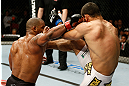 GOLD COAST, AUSTRALIA - DECEMBER 15:  (L-R) Hector Lombard punches Rousimar Palhares during their middleweight fight at the UFC on FX event on December 15, 2012  at Gold Coast Convention and Exhibition Centre in Gold Coast, Australia.  (Photo by Josh Hedges/Zuffa LLC/Zuffa LLC via Getty Images)