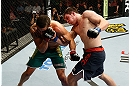 GOLD COAST, AUSTRALIA - DECEMBER 15:  (R-L) Bradley Scott punches Robert Whittaker during their welterweight fight at the UFC on FX event on December 15, 2012  at Gold Coast Convention and Exhibition Centre in Gold Coast, Australia.  (Photo by Josh Hedges/Zuffa LLC/Zuffa LLC via Getty Images)