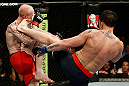GOLD COAST, AUSTRALIA - DECEMBER 15:  (R-L) Norman Parke kicks Colin Fletcher during their lightweight fight at the UFC on FX event on December 15, 2012  at Gold Coast Convention and Exhibition Centre in Gold Coast, Australia.  (Photo by Josh Hedges/Zuffa LLC/Zuffa LLC via Getty Images)