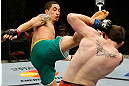 GOLD COAST, AUSTRALIA - DECEMBER 15:  (L-R) Robert Whittaker kicks Bradley Scott during their welterweight fight at the UFC on FX event on December 15, 2012  at Gold Coast Convention and Exhibition Centre in Gold Coast, Australia.  (Photo by Josh Hedges/Zuffa LLC/Zuffa LLC via Getty Images)