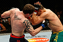GOLD COAST, AUSTRALIA - DECEMBER 15:  (L-R) Bradley Scott punches Robert Whittaker during their welterweight fight at the UFC on FX event on December 15, 2012  at Gold Coast Convention and Exhibition Centre in Gold Coast, Australia.  (Photo by Josh Hedges/Zuffa LLC/Zuffa LLC via Getty Images)