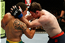GOLD COAST, AUSTRALIA - DECEMBER 15:  (L-R) Robert Whittaker punches Bradley Scott during their welterweight fight at the UFC on FX event on December 15, 2012  at Gold Coast Convention and Exhibition Centre in Gold Coast, Australia.  (Photo by Josh Hedges/Zuffa LLC/Zuffa LLC via Getty Images)