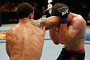 GOLD COAST, AUSTRALIA - DECEMBER 15:  (L-R) Robert Whittaker elbows Bradley Scott during their welterweight fight at the UFC on FX event on December 15, 2012  at Gold Coast Convention and Exhibition Centre in Gold Coast, Australia.  (Photo by Josh Hedges/Zuffa LLC/Zuffa LLC via Getty Images)