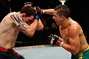 GOLD COAST, AUSTRALIA - DECEMBER 15:  (R-L) Robert Whittaker punches Bradley Scott during their welterweight fight at the UFC on FX event on December 15, 2012  at Gold Coast Convention and Exhibition Centre in Gold Coast, Australia.  (Photo by Josh Hedges/Zuffa LLC/Zuffa LLC via Getty Images)