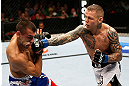 GOLD COAST, AUSTRALIA - DECEMBER 15:  (R-L) Ross Pearson punches George Sotiropoulos during their lightweight fight at the UFC on FX event on December 15, 2012  at Gold Coast Convention and Exhibition Centre in Gold Coast, Australia.  (Photo by Josh Hedges/Zuffa LLC/Zuffa LLC via Getty Images)