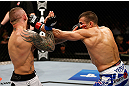 GOLD COAST, AUSTRALIA - DECEMBER 15:  (R-L) George Sotiropoulos punches Ross Pearson during their lightweight fight at the UFC on FX event on December 15, 2012  at Gold Coast Convention and Exhibition Centre in Gold Coast, Australia.  (Photo by Josh Hedges/Zuffa LLC/Zuffa LLC via Getty Images)