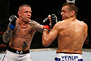 GOLD COAST, AUSTRALIA - DECEMBER 15:  (L-R) Ross Pearson punches George Sotiropoulos during their lightweight fight at the UFC on FX event on December 15, 2012  at Gold Coast Convention and Exhibition Centre in Gold Coast, Australia.  (Photo by Josh Hedges/Zuffa LLC/Zuffa LLC via Getty Images)