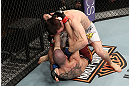 LAS VEGAS, NV - DECEMBER 15:  Timothy Elliott (top) punches Jared Papazian (bottom) during their flyweight fight at the TUF 16 Finale on December 15, 2012  at the Joint at the Hard Rock in Las Vegas, Nevada.  (Photo by Jim Kemper/Zuffa LLC/Zuffa LLC via Getty Images) *** Local Caption ***Jared Papazian; Timothy Elliott
