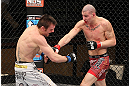 LAS VEGAS, NV - DECEMBER 15:  (R-L) Jared Papazian punches Timothy Elliott during their flyweight fight at the TUF 16 Finale on December 15, 2012  at the Joint at the Hard Rock in Las Vegas, Nevada.  (Photo by Jim Kemper/Zuffa LLC/Zuffa LLC via Getty Images) *** Local Caption ***Jared Papazian; Timothy Elliott