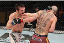 LAS VEGAS, NV - DECEMBER 15:  (L-R) Timothy Elliott punches Jared Papazian during their flyweight fight at the TUF 16 Finale on December 15, 2012  at the Joint at the Hard Rock in Las Vegas, Nevada.  (Photo by Jim Kemper/Zuffa LLC/Zuffa LLC via Getty Images) *** Local Caption ***Jared Papazian; Timothy Elliott