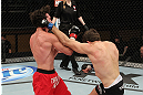 LAS VEGAS, NV - DECEMBER 15:  (R-L) John Cofer punches Mike Rio during their lightweight fight at the TUF 16 Finale on December 15, 2012  at the Joint at the Hard Rock in Las Vegas, Nevada.  (Photo by Jim Kemper/Zuffa LLC/Zuffa LLC via Getty Images) *** Local Caption *** Mike Rio; John Cofer