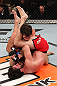 LAS VEGAS, NV - DECEMBER 15:  Mike Rio (red shorts) attempts to submit John Cofer during their lightweight fight at the TUF 16 Finale on December 15, 2012  at the Joint at the Hard Rock in Las Vegas, Nevada.  (Photo by Jim Kemper/Zuffa LLC/Zuffa LLC via Getty Images) *** Local Caption *** Mike Rio; John Cofer