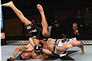LAS VEGAS, NV - DECEMBER 15:  Rustam Khabilov (white shorts) slams Vinc Pichel during their lightweight fight at the TUF 16 Finale on December 15, 2012  at the Joint at the Hard Rock in Las Vegas, Nevada.  (Photo by Jim Kemper/Zuffa LLC/Zuffa LLC via Getty Images) *** Local Caption *** Vinc Pichel; Rustam Khabilov