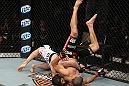 LAS VEGAS, NV - DECEMBER 15:  (L-R) Rustam Khabilov slams Vinc Pichel during their lightweight fight at the TUF 16 Finale on December 15, 2012  at the Joint at the Hard Rock in Las Vegas, Nevada.  (Photo by Jim Kemper/Zuffa LLC/Zuffa LLC via Getty Images) *** Local Caption *** Vinc Pichel; Rustam Khabilov