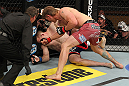 LAS VEGAS, NV - DECEMBER 15:  (R-L) Mike Pyle punches James Head as referee Steve Mazzagatti looks on during their welterweight fight at the TUF 16 Finale on December 15, 2012  at the Joint at the Hard Rock in Las Vegas, Nevada.  (Photo by Jim Kemper/Zuffa LLC/Zuffa LLC via Getty Images) *** Local Caption *** Mike Pyle; James Head