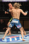 LAS VEGAS, NV - DECEMBER 15:  Dustin Poirier (black shorts) and Jonathan Poirier (blue shorts) exchange punches during their featherweight fight at the TUF 16 Finale on December 15, 2012  at the Joint at the Hard Rock in Las Vegas, Nevada.  (Photo by Jim Kemper/Zuffa LLC/Zuffa LLC via Getty Images) *** Local Caption *** Dustn Poirier; Jonathan Brookins
