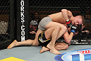 LAS VEGAS, NV - DECEMBER 15:  Colton Smith (grey shorts) attempts to submit Mike Ricci during their lightweight fight at the TUF 16 Finale on December 15, 2012  at the Joint at the Hard Rock in Las Vegas, Nevada.  (Photo by Jim Kemper/Zuffa LLC/Zuffa LLC via Getty Images) *** Local Caption *** Colton Smith; Mike Ricci