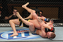 LAS VEGAS, NV - DECEMBER 15:  Colton Smith (bottom) attempts to submit Mike Ricci during their lightweight fight at the TUF 16 Finale on December 15, 2012  at the Joint at the Hard Rock in Las Vegas, Nevada.  (Photo by Jim Kemper/Zuffa LLC/Zuffa LLC via Getty Images) *** Local Caption *** Colton Smith; Mike Ricci