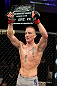 LAS VEGAS, NV - DECEMBER 15:  Colton Smith lifts the Ultimate Fighter season 16 trophy after his lightweight fight at the TUF 16 Finale on December 15, 2012  at the Joint at the Hard Rock in Las Vegas, Nevada.  (Photo by Jim Kemper/Zuffa LLC/Zuffa LLC via Getty Images) *** Local Caption *** Colton Smith; Mike Ricci