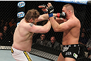 LAS VEGAS, NV - DECEMBER 15:  (L-R) Roy Nelson punches Matt Mitrione during their heavyweight fight at the TUF 16 Finale on December 15, 2012  at the Joint at the Hard Rock in Las Vegas, Nevada.  (Photo by Jim Kemper/Zuffa LLC/Zuffa LLC via Getty Images) *** Local Caption *** Roy Nelson; Matt Mitrione