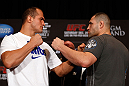 LAS VEGAS, NV - DECEMBER 27:  (L-R) Opponents Junior dos Santos and Cain Velasquez face off during the final UFC 155 pre-fight press conference on December 27, 2012 at MGM Grand in Las Vegas, Nevada. (Photo by Josh Hedges/Zuffa LLC/Zuffa LLC via Getty Images)