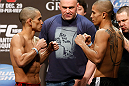 LAS VEGAS, NV - DECEMBER 28:  (L-R) Opponents Chris Cariaso and John Moraga face off during the UFC 155 weigh-in on December 28, 2012 at MGM Grand Garden Arena in Las Vegas, Nevada. (Photo by Josh Hedges/Zuffa LLC/Zuffa LLC via Getty Images)