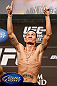 LAS VEGAS, NV - DECEMBER 28:  Max Holloway gestures during the UFC 155 weigh-in on December 28, 2012 at MGM Grand Garden Arena in Las Vegas, Nevada. (Photo by Josh Hedges/Zuffa LLC/Zuffa LLC via Getty Images)