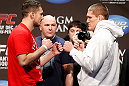 LAS VEGAS, NV - DECEMBER 28:  (L-R) Opponents Phil De Fries and Todd Duffee face off during the UFC 155 weigh-in on December 28, 2012 at MGM Grand Garden Arena in Las Vegas, Nevada. (Photo by Josh Hedges/Zuffa LLC/Zuffa LLC via Getty Images)