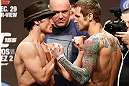 LAS VEGAS, NV - DECEMBER 28:  (L-R) Opponents Brad Pickett and Eddie Wineland face off during the UFC 155 weigh-in on December 28, 2012 at MGM Grand Garden Arena in Las Vegas, Nevada. (Photo by Josh Hedges/Zuffa LLC/Zuffa LLC via Getty Images)